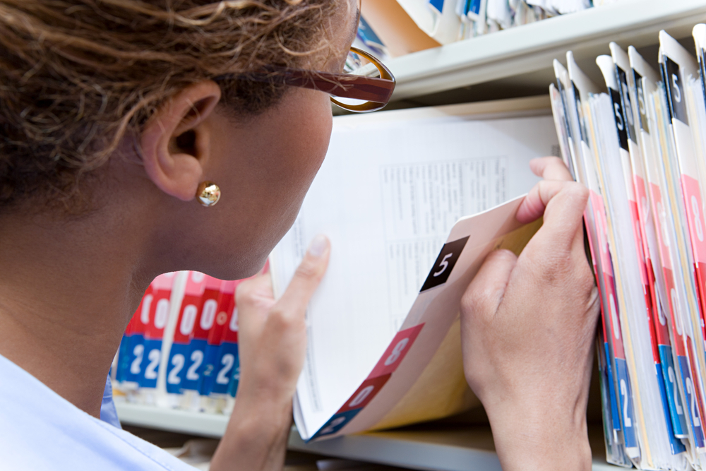 young-woman-filing-medical-records